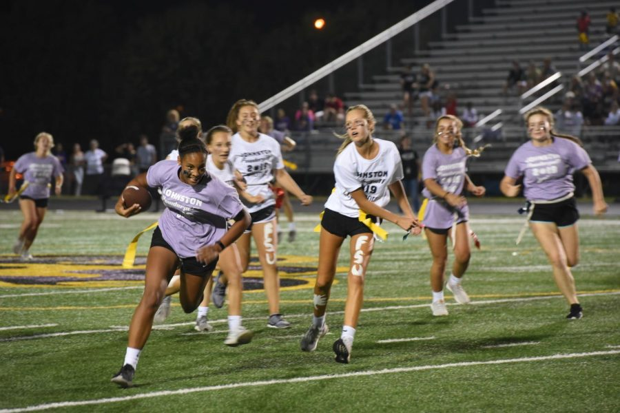 Running back Kaliyan Burkett '21 sprints down the field before the sophomore defenders behind her snatch her flag for the tackle.