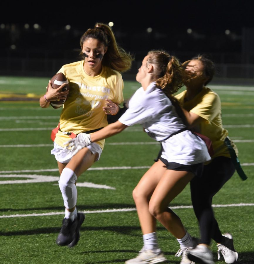 Hope Ung '20 tries to block a defender so that Maya McDermott '20 can reach the first down.