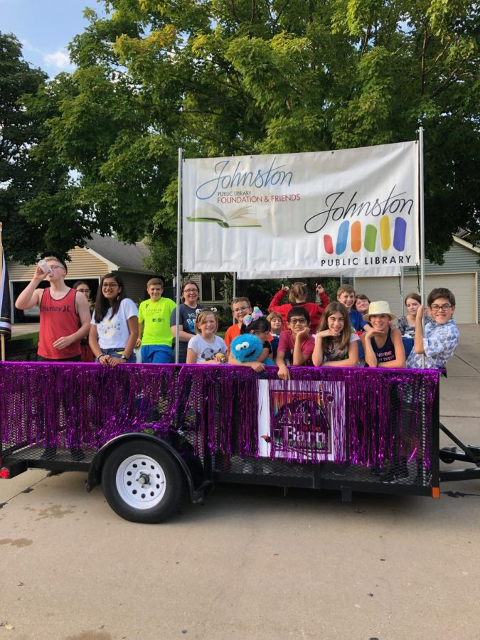 Jessica Young and a group of students representing the Library in the parade.