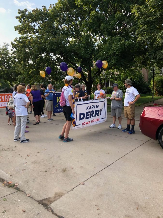 Karin Derry and her team walking the parade. She is running for Iowa House in the upcoming election.