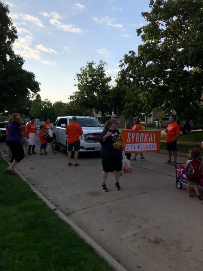 Scott Syroka's campaign team during the homecoming parade. He is running for City Council in the upcoming election.