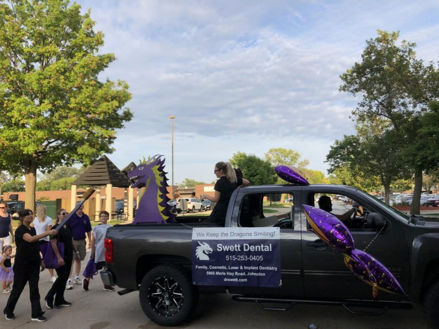 Swett Dental entertained kids at the homecoming parade by making a cool dragon out of cardboard.
