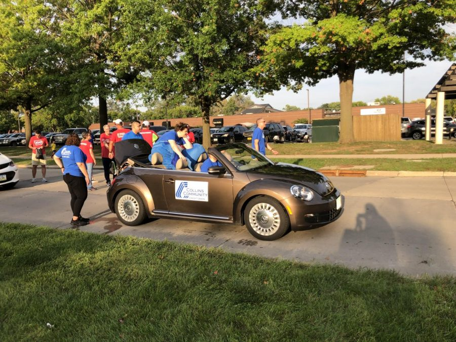 Collin's community choice bank crew was prepared for this parade by getting a tiny car for a larger group of people.