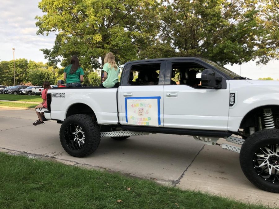 The truck Vandee's used for kids sitting in the back and throwing out candy. They know the routine for entertaining kids at the homecoming parade.