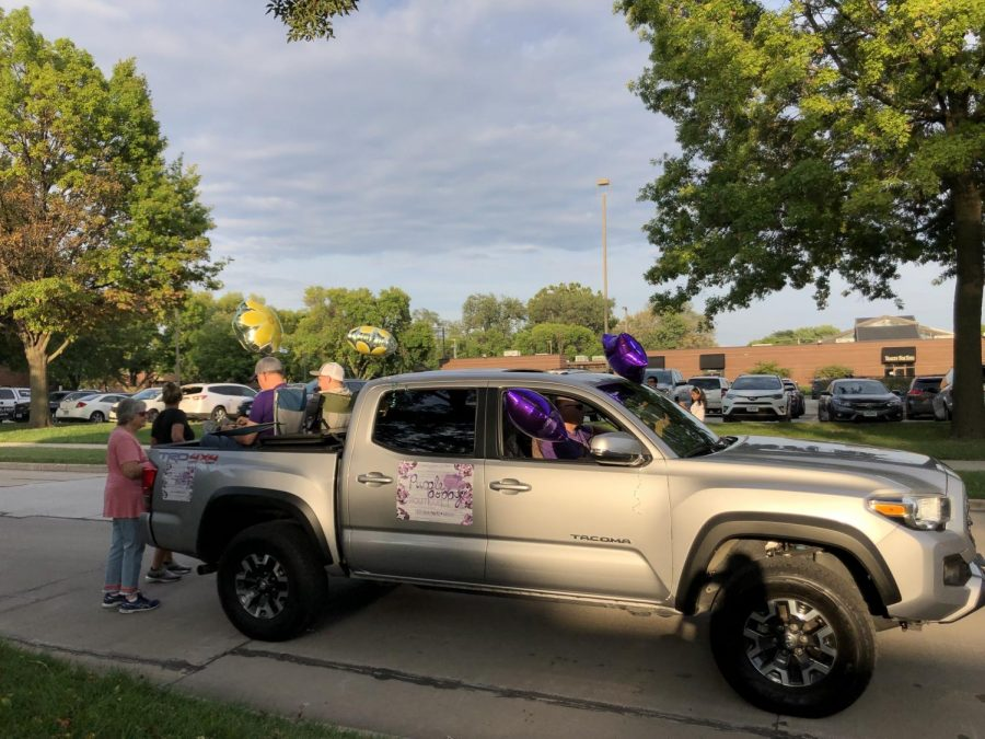 The truck for Purple Poppy, the new boutique on Merle Hay by Ace Hardware. This was their first year participating in the homecoming parade.