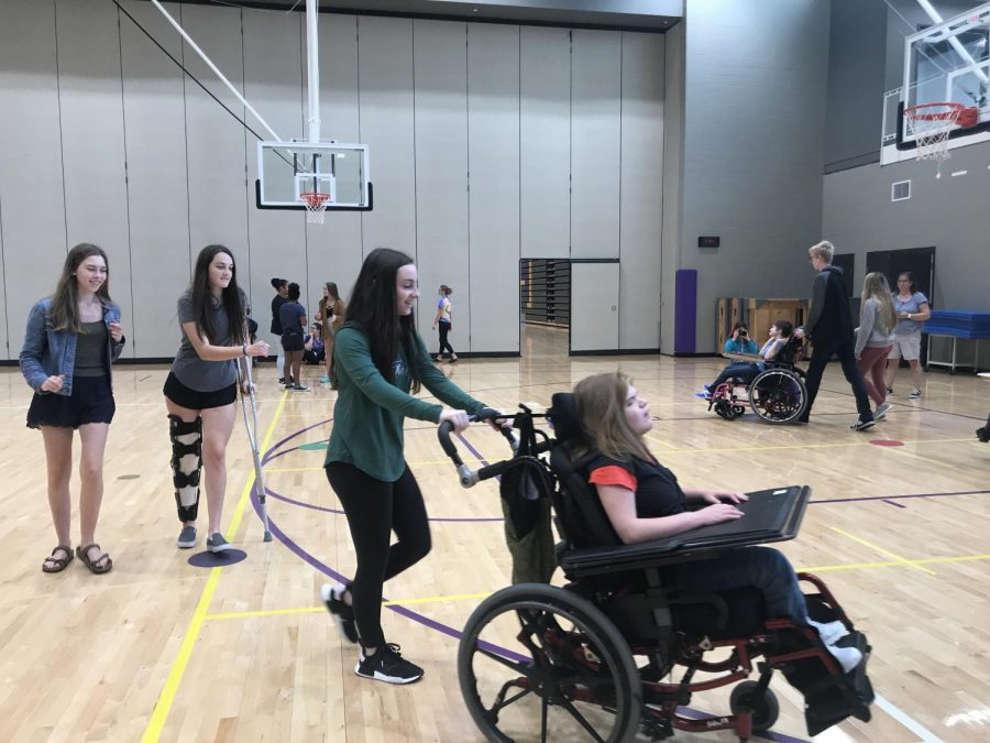 Sarah Linder '22 smiles as she enjoys playing musical chairs with her buddy.