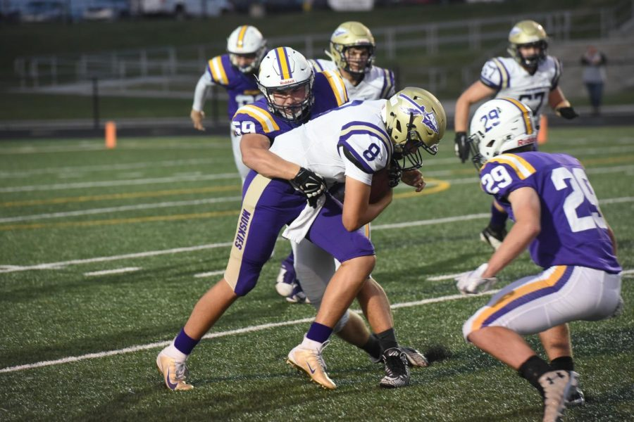 Johnston shuts Muscatine out 14-0