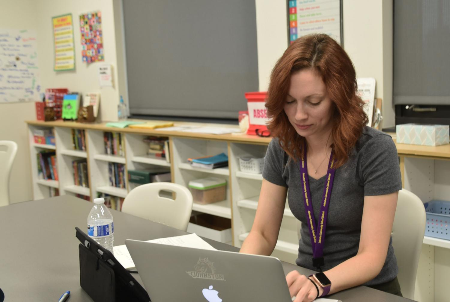 Sarah Love checking her emails before her class begins.