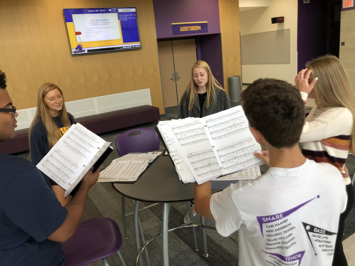 Choir Students practicing in the auditorium commons during Dragon Time.