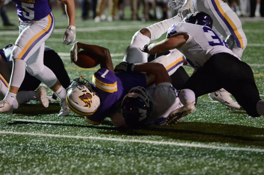 Alvin Brisbane '20 extends his arm in an attempt to score a touchdown. Brisbane had 8 carries for 47 yards