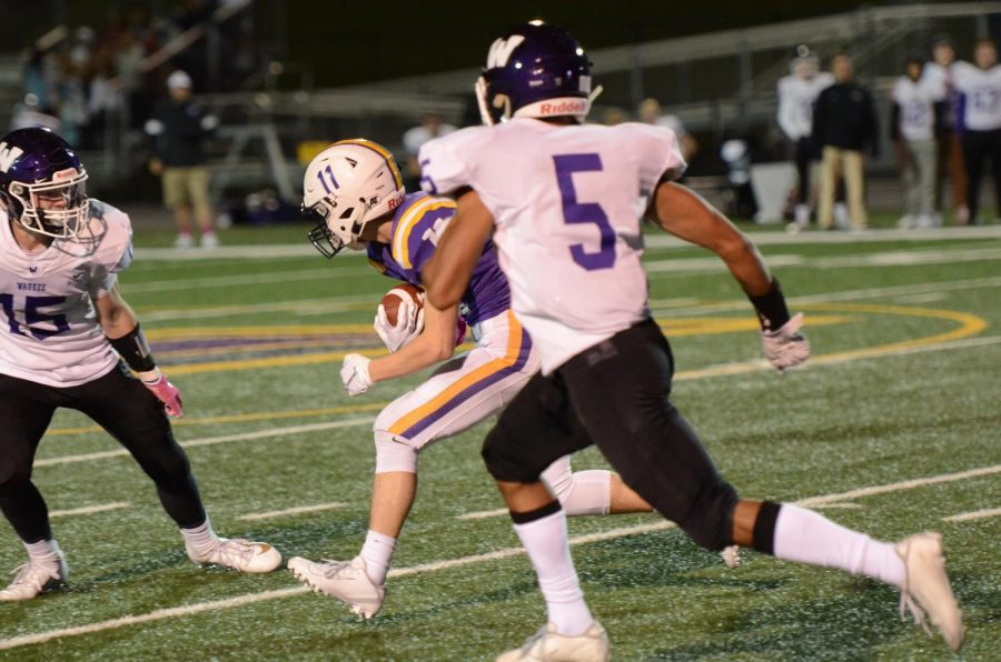 Jordan Rusch '20 prepares for an Waukee defender's tackle. That game Rusch had 5 carries for 26 yards