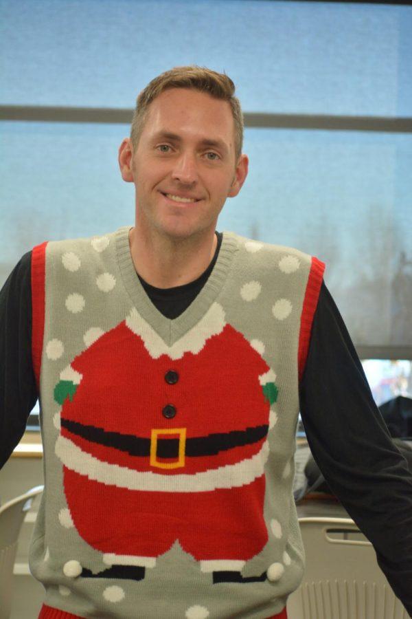 Tyler Milklo wearing a ugly Santa sweater