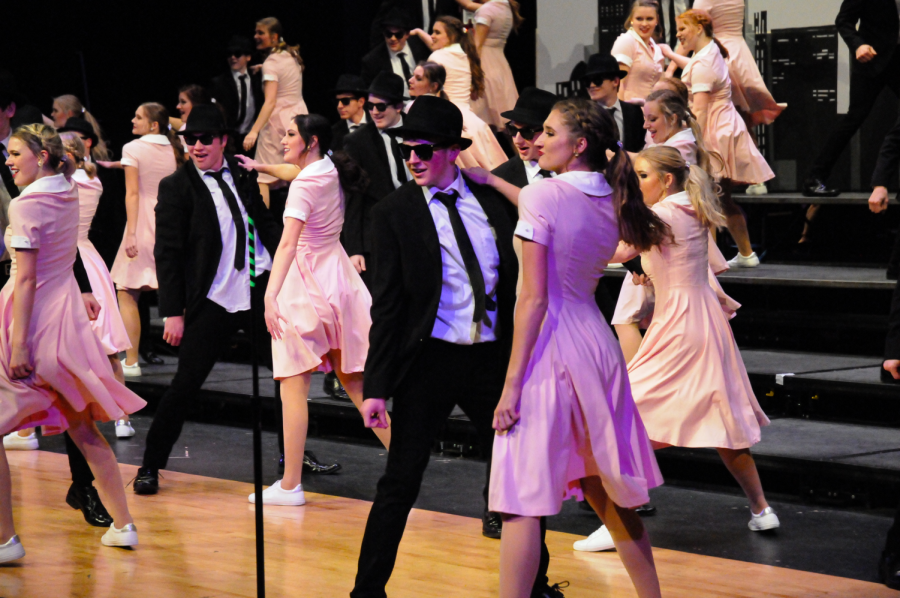 Couples perform their choreography. Show choir member Emma Dummermouth '22 said,
