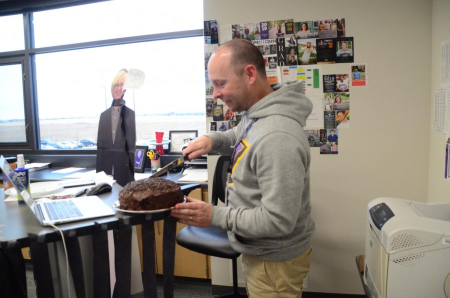 Rod+Wiebers+cuts+into+a+cake+given+to+him+as+a+surprise+from+some+students+for+his+40th+birthday.