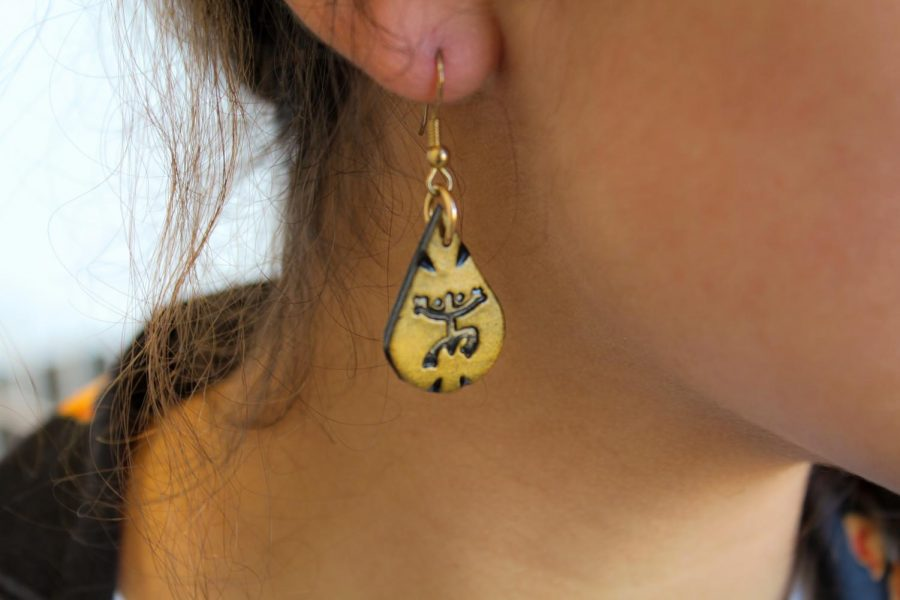 Fabiola Castaneda '21 sporting earrings made from her birthplace.