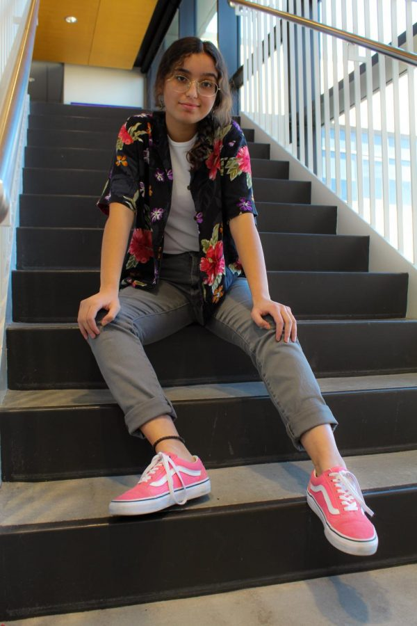 Fabiola Castaneda '21 casually posses on stairs.