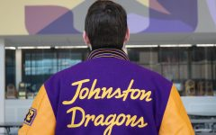Dylan Coslin 22 shows off his custom Johnston Letterman jacket. He bought a customized jacket at the beginning of 2019 to wear his academic letter and show school spirit.