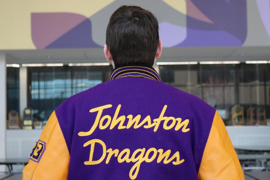 Dylan+Coslin+%2722+shows+off+his+custom+Johnston+Letterman+jacket.+He+bought+a+customized+jacket+at+the+beginning+of+2019+to+wear+his+academic+letter+and+show+school+spirit.