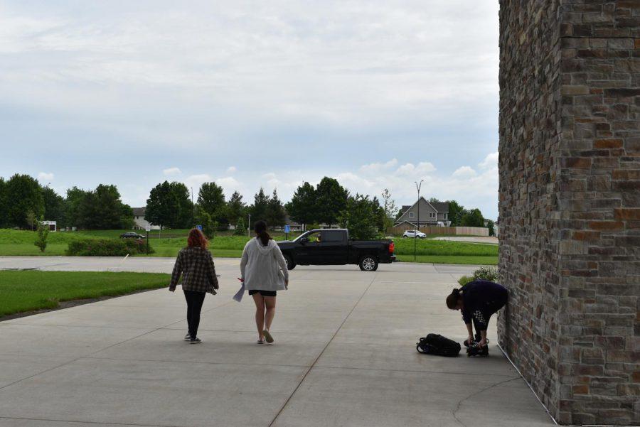 Kathleen Menke walks a student back to their car.