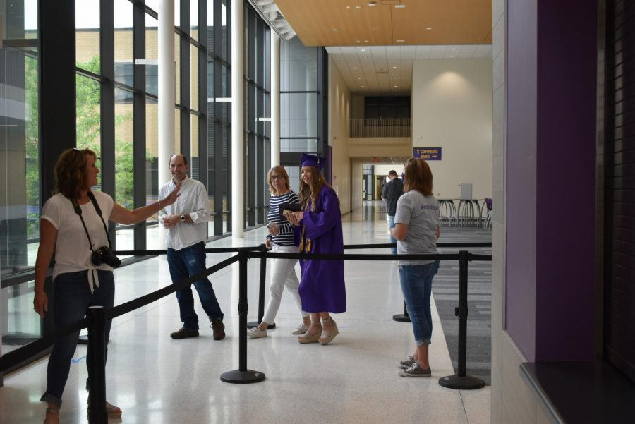 Kassie Pietsch '20 leaving the auditorium and exiting the building.