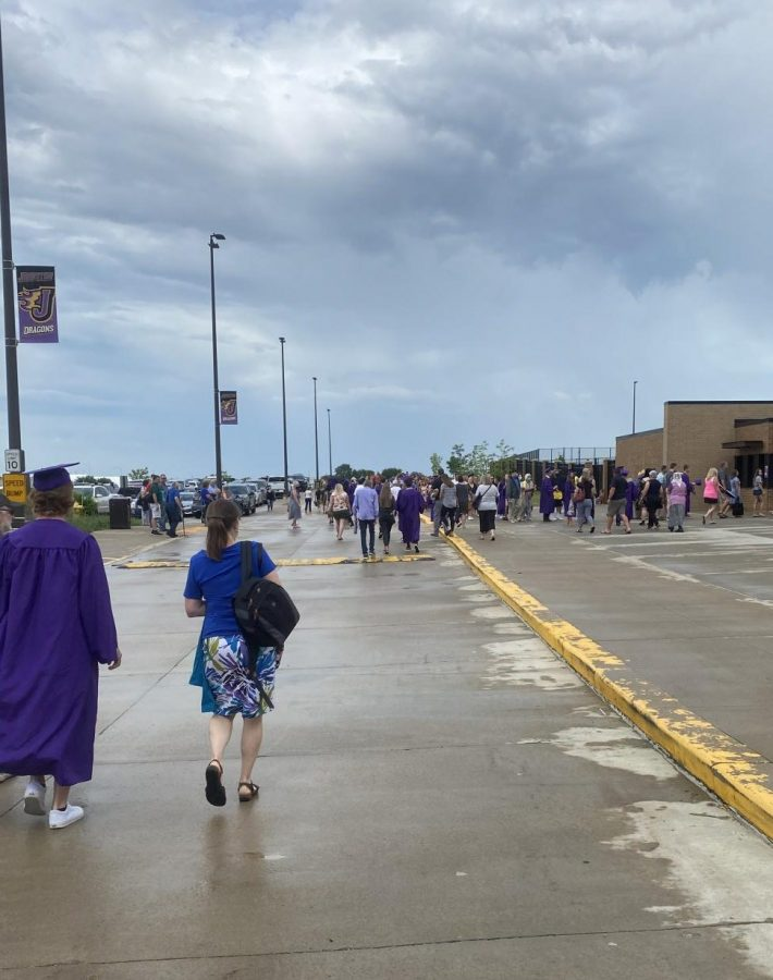 Family and friends walk to the line that allows them entry into the stadium that held the commencement ceremony that took place on June 27.