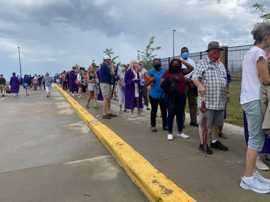 Family and friends of graduates wait in line to enter the stadium for the commencement ceremony that took place in the stadium on June 27.