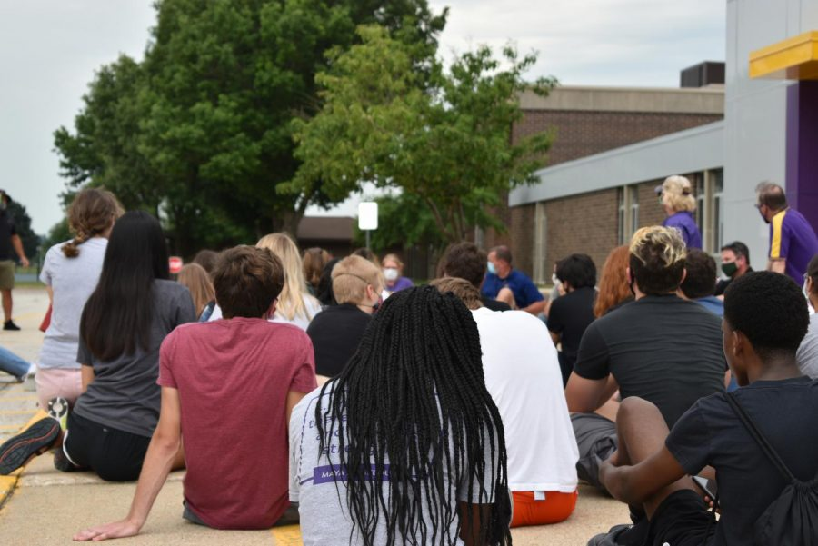 Administration introduces themselves to the students and community members who arrived at the middle school. Community members staged a march at the middle school June 26 to address inequality and racism in the district.