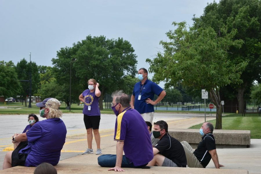 Superintendent Laura Kacer and middle school Principal Brent Riessen stand among other members of administration who attended the march. Community members staged a march at the middle school June 26 to address inequality and racism in the district.