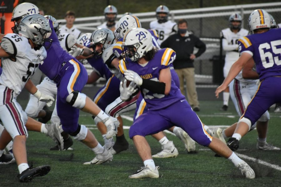 Noah Storts '21 receiving the handoff. Making his way though the defensive line.