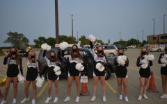The Varsity Dance Team boosting parades goers school spirit.