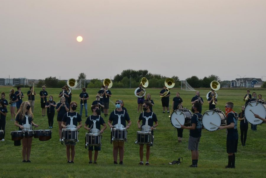 JHS Varsity Marching Band and Drum-line welcoming all parade attendees at the beginning of the parade lineup.