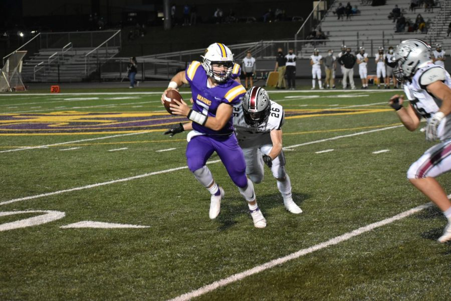 Jack Rutz '22 rushing for a first down. Rutz managed to connect some key passes during the game.