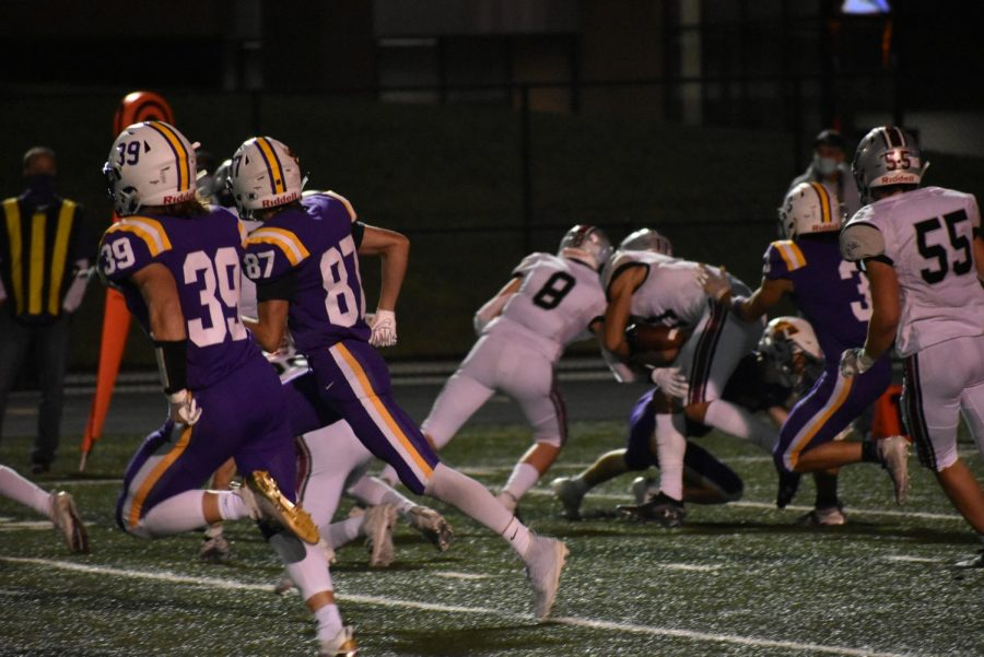 The Dragons defense stopping a run. Johnston's defensive line stood out by shutting down the run game.