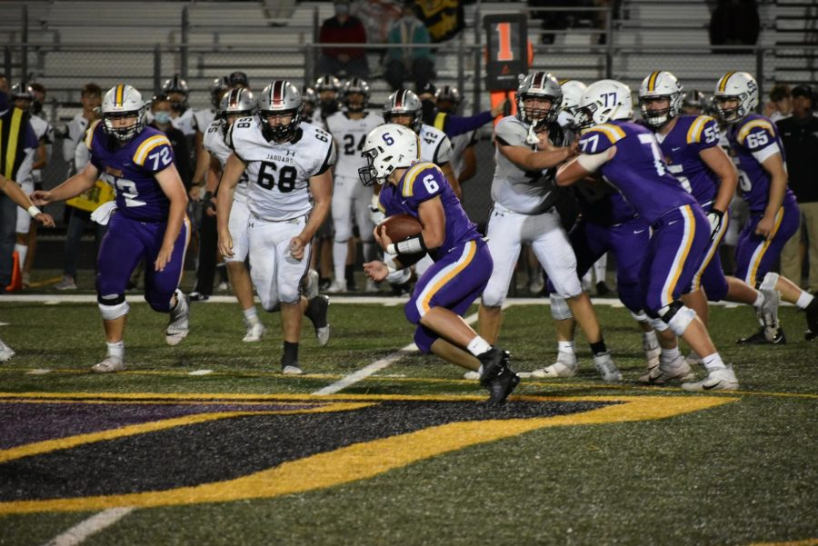 Blake Tubbs 23 making his way upfield. The sophomore has proven himself as one of the few sophomores on varsity.