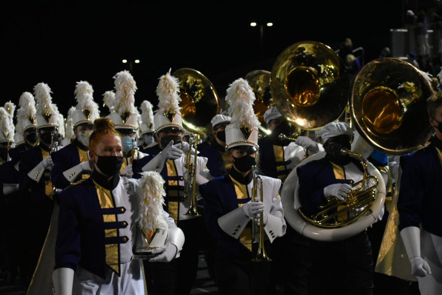 The Johnston Marching Band exiting Dragon Stadium.