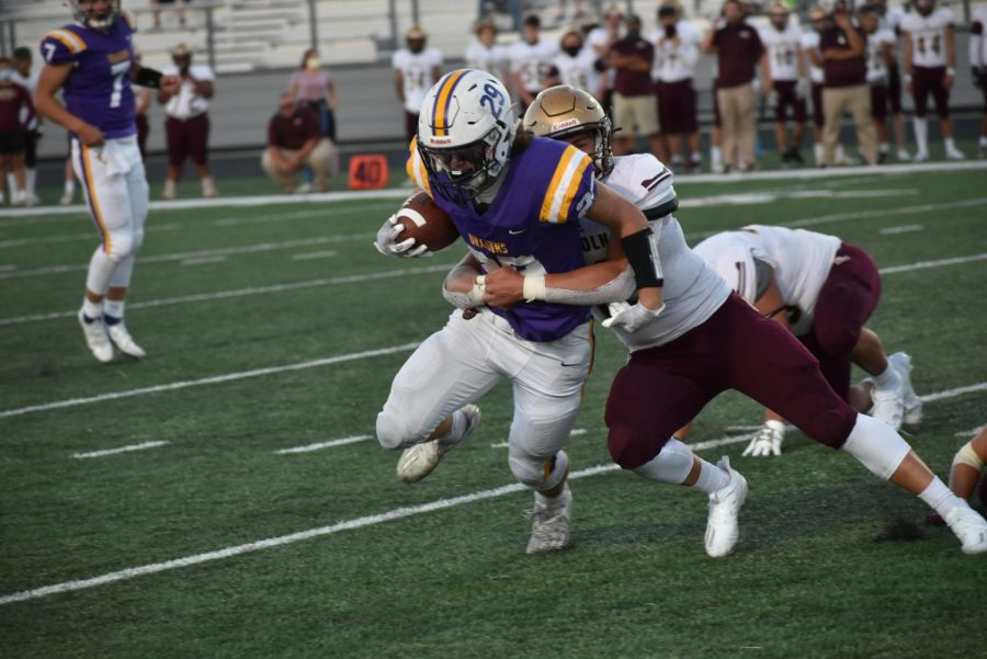 Noah Storts '22 Rushing into the end zone.