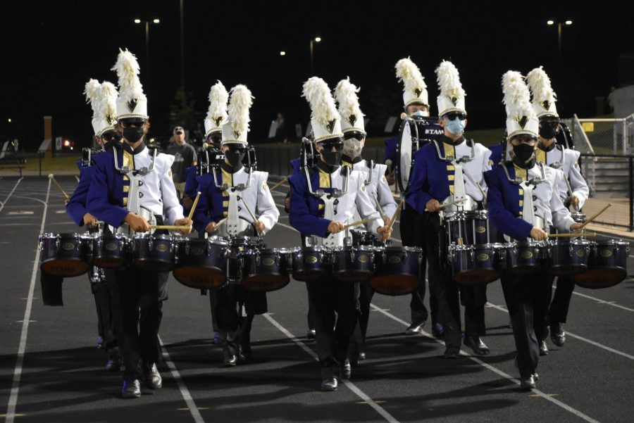 The Drum line preforming the fight song.