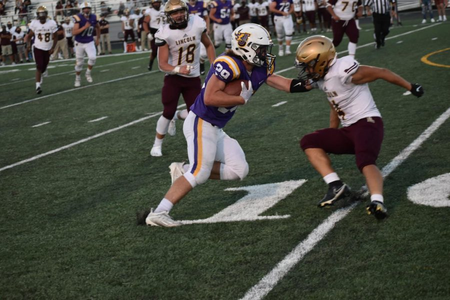 Tyler Moore '21 about to enter the end zone.