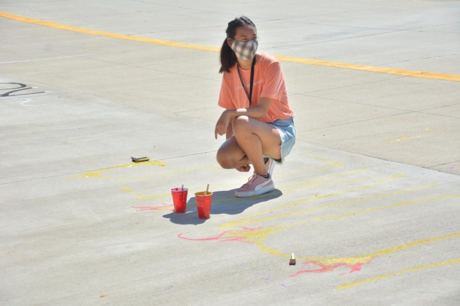 Kristen Tu '22 helping paint the student council stadium painting on Sept. 13 at the high school to kick off homecoming week.