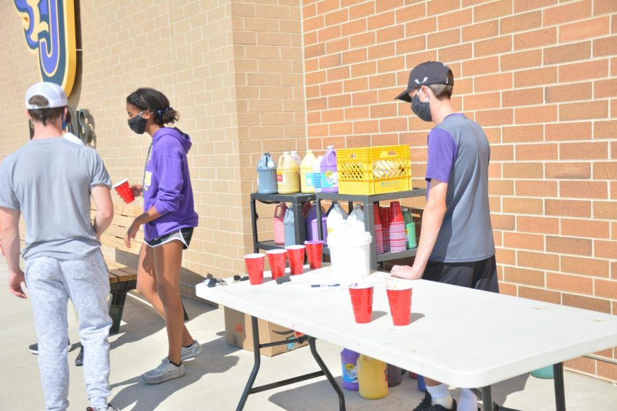 Student council representatives manning the paint station at stadium painting on Sept. 13 at the high school for homecoming week.