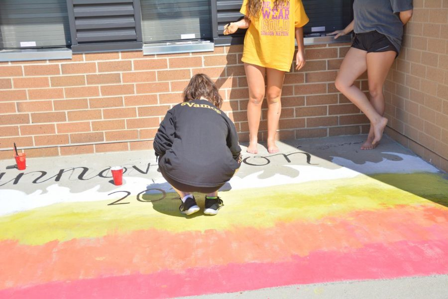 Jenna Curry '21 putting finishing touches on the Innovation stadium painting on Sept. 13 held at the high school.