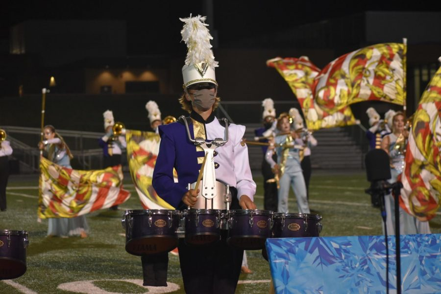 Calen Bishop 22 performing at the end of the drumline feature.