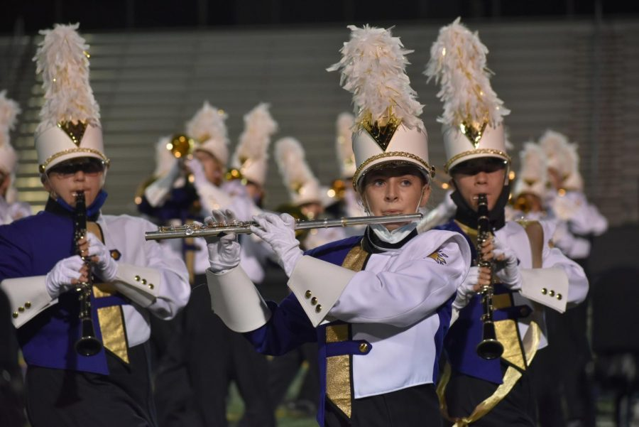 Lily Flemming '23 marching through opener of the show.