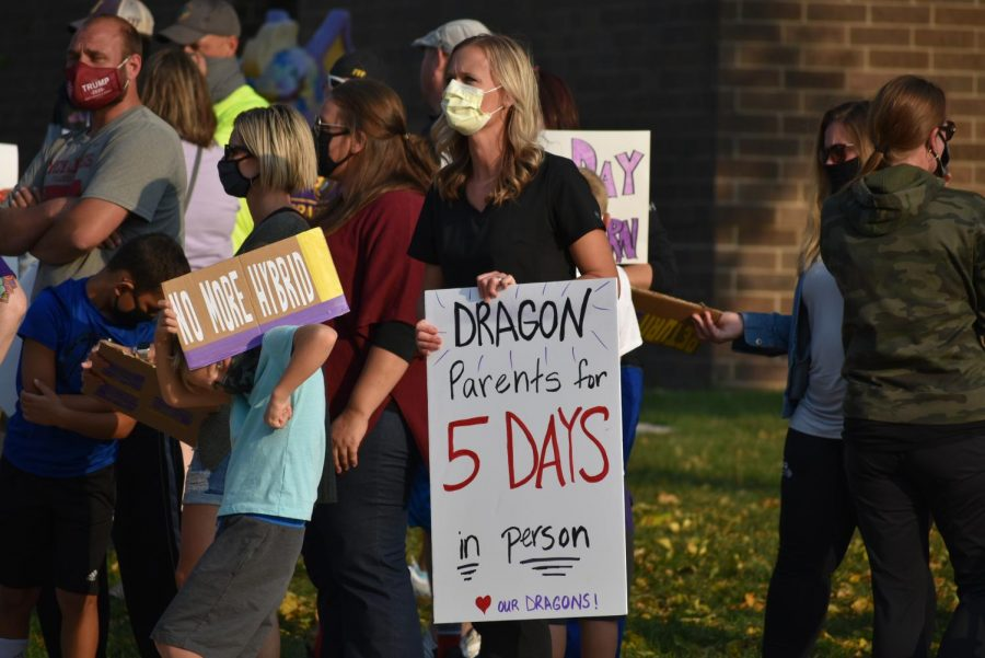 A parent advocates for five days back at school. Supporters of the five-day return to learn plan gathered in front of the district office Oct. 8 to voice their opinions. The board voted 5-2 to scrap the hybrid plan and planned for students to return to school every day Oct. 26.
