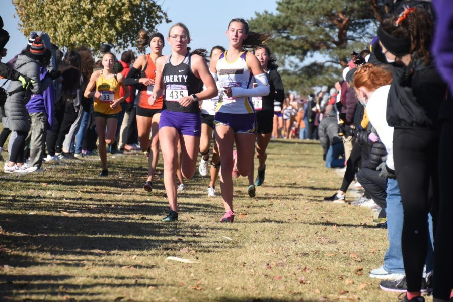 Bella Heikes '21 finishes the race. Bella Heikes was the top runner on the team as she placed third overall with a 18:20. the Girls' cross country team won their fourth state title in five years.