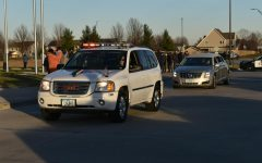 People wave and give their condolences while the family of Jill Morrill during the Memorial Reverse Parade.