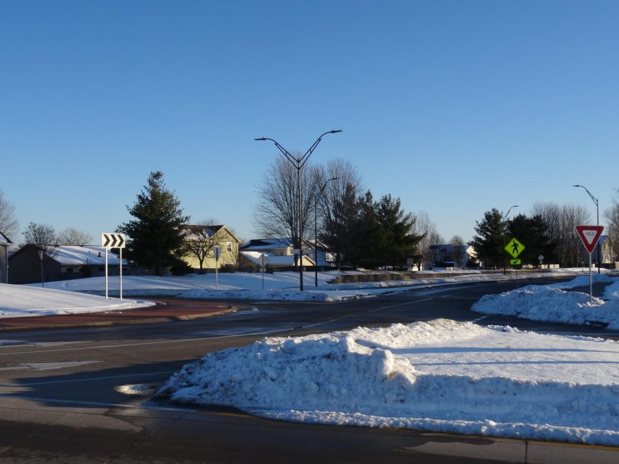 Located on 100th St, this roundabout which is usually busy is in a state of calm.