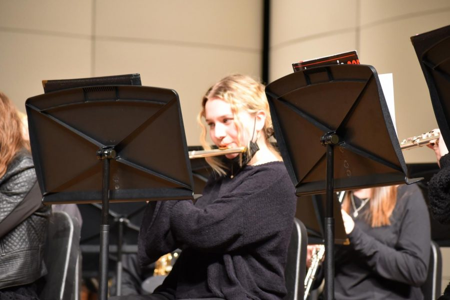 Avery Watson 21 is performing at the band concert. She plays the flute for concert band.