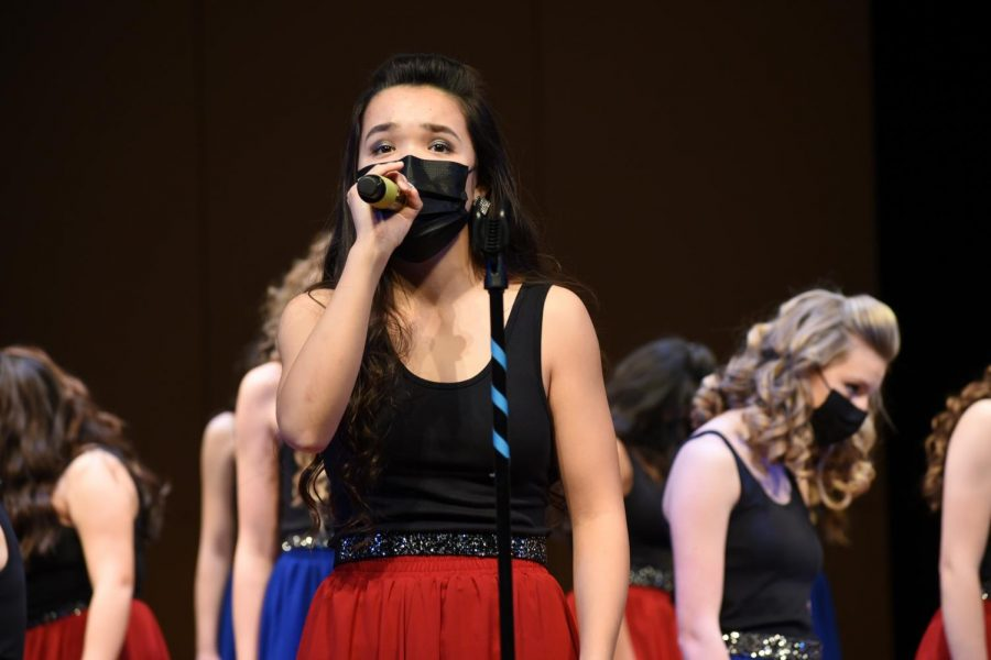 Waverly Zhao 23, singing her solo in Bella Voces ballad.