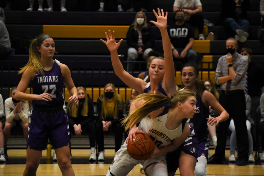 Aili Tanke 24 powers her way through two defenders for two points. The girls beat Indianola High 84-61